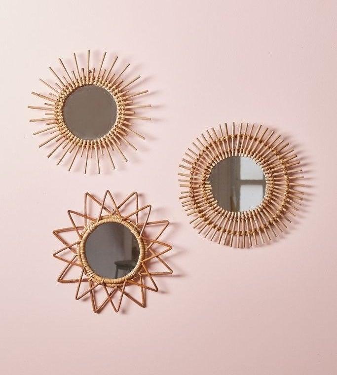 Three round mirrors with sunburst patterns woven on rims