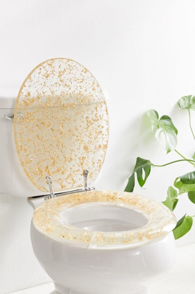 The Metallic-Flecked Toilet Seat in gold