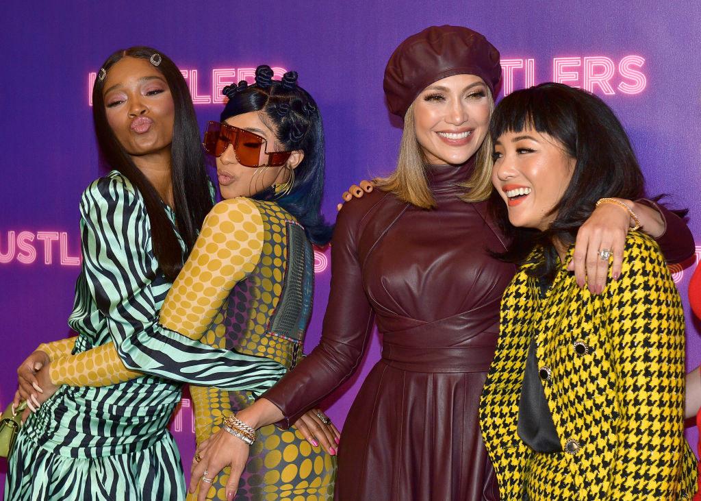 Jennifer Lopez smiling with the Hustlers cast