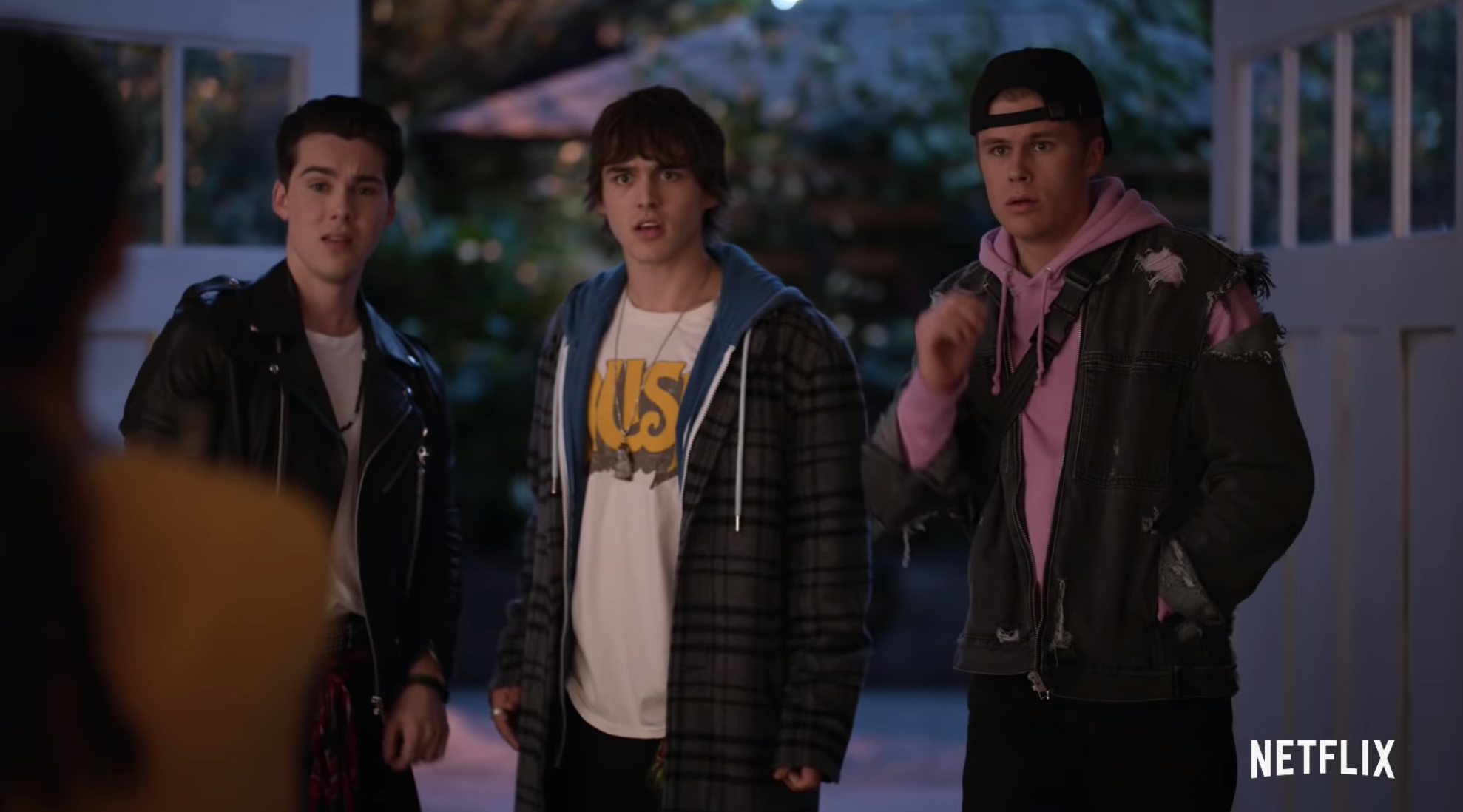 Reggie, Luke, and Alex looking at Julie like SHE'S the ghost.