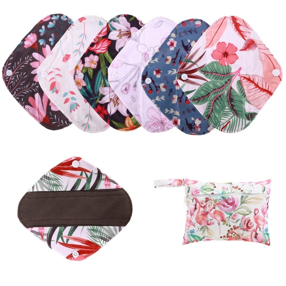 Six pads with different patterned fabrics and a little storage bag