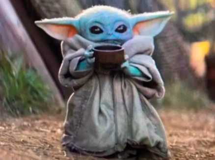 Baby Yoda holding a cup of tea