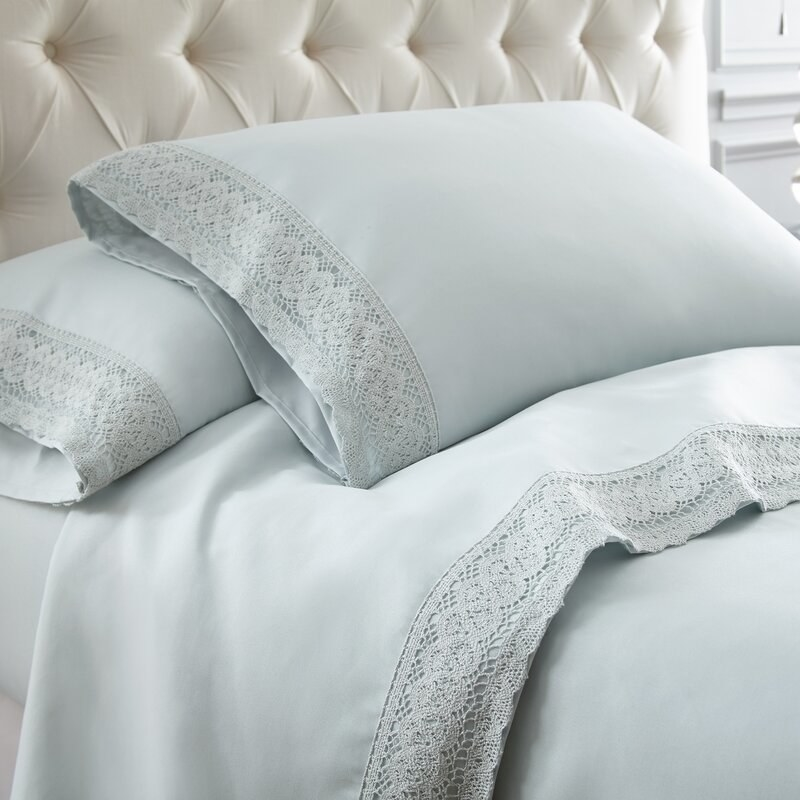 Mistana sheets with a crochet lace detailing at the edge of the sheets and pillowcases