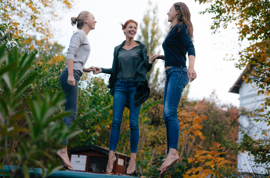 Three girls jumping for joy