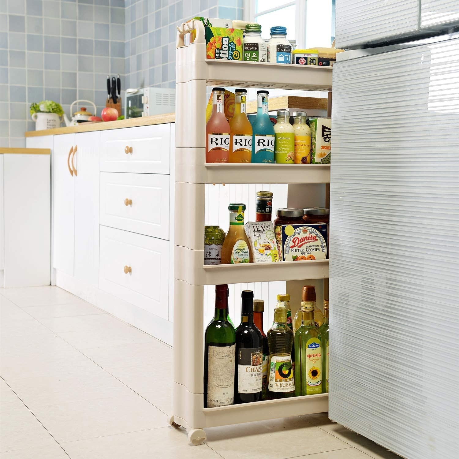 Off-white plastic shelves wedged between a refrigerator and a counterspace