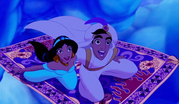 """A screenshot of Princess Jasmine and Aladdin (as Prince Ali) flying on carpet through the sky during the """"A Whole New World"""" scene"""
