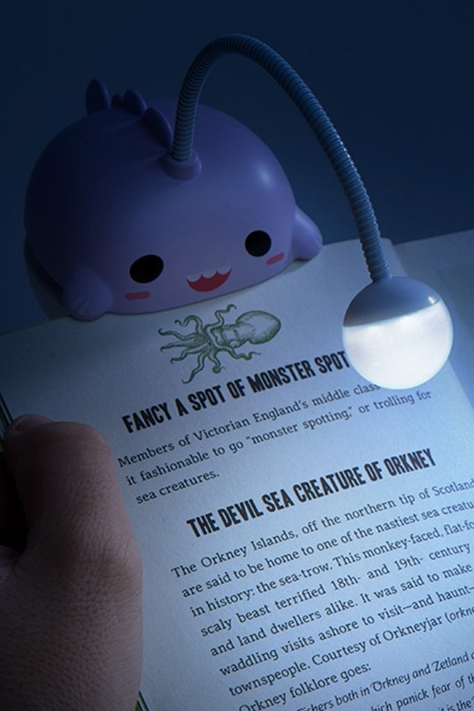 a purple anglerfish attached to a book