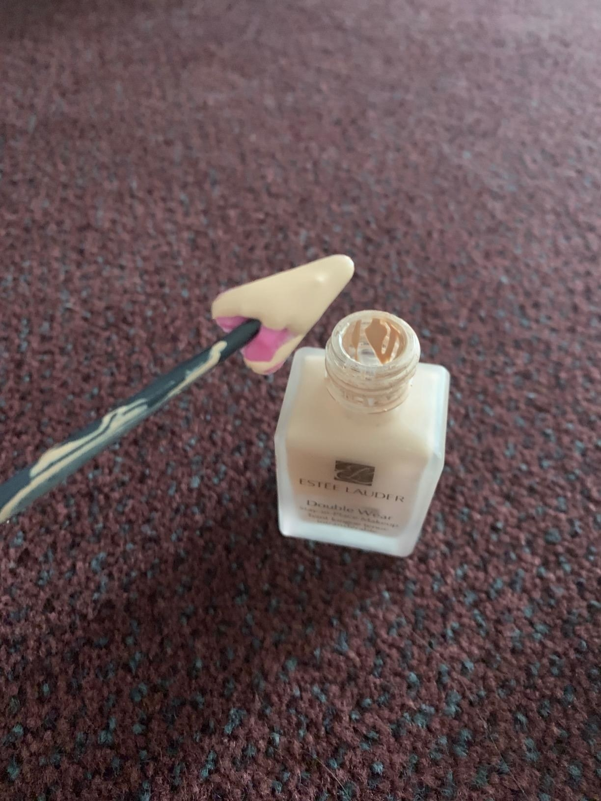 reviewer photo of the spatula being used in foundation bottle