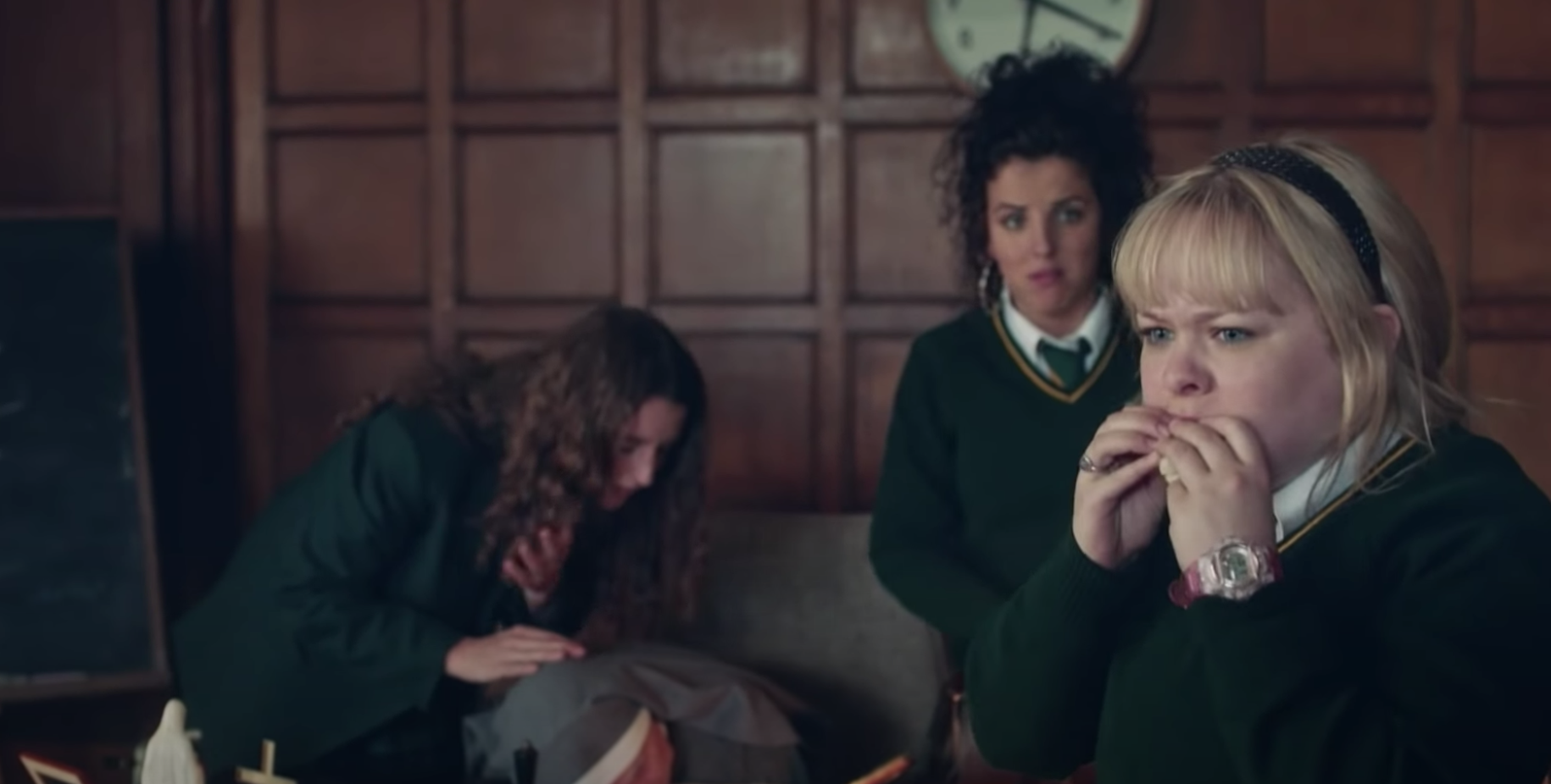 """Michelle, Orla, and Clare in a classroom in """"Derry Girls."""""""