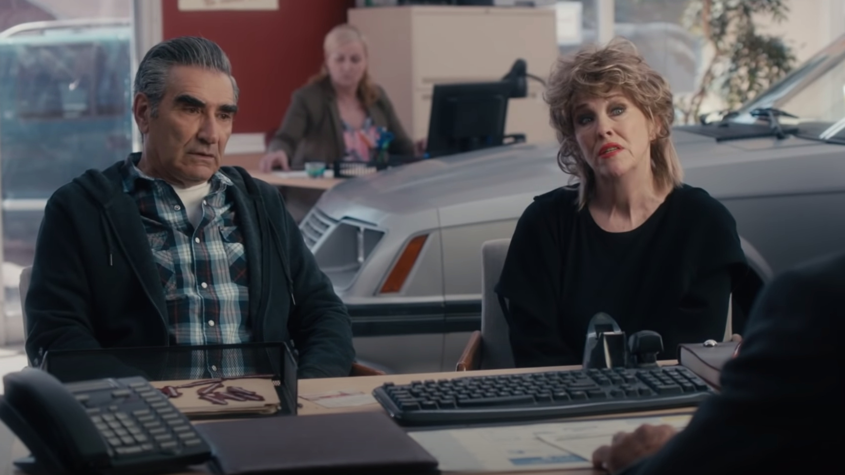 "Johnny and Moira look concerned in ""Schitt's Creek."""