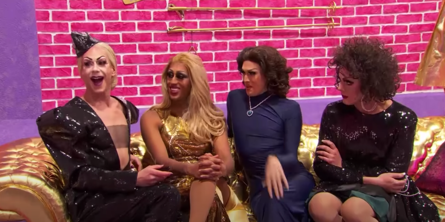 """RuPaul's Drag Race"" cast sits together on a couch and shares a laugh."