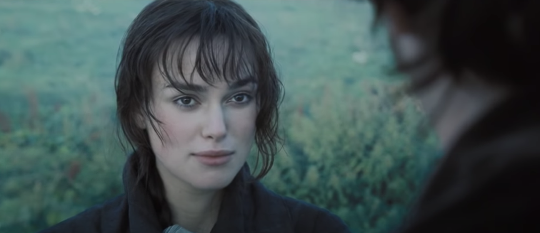 "Elizabeth looks at Mr. Darcy as he confesses his love for her in ""Pride and Prejudice."""