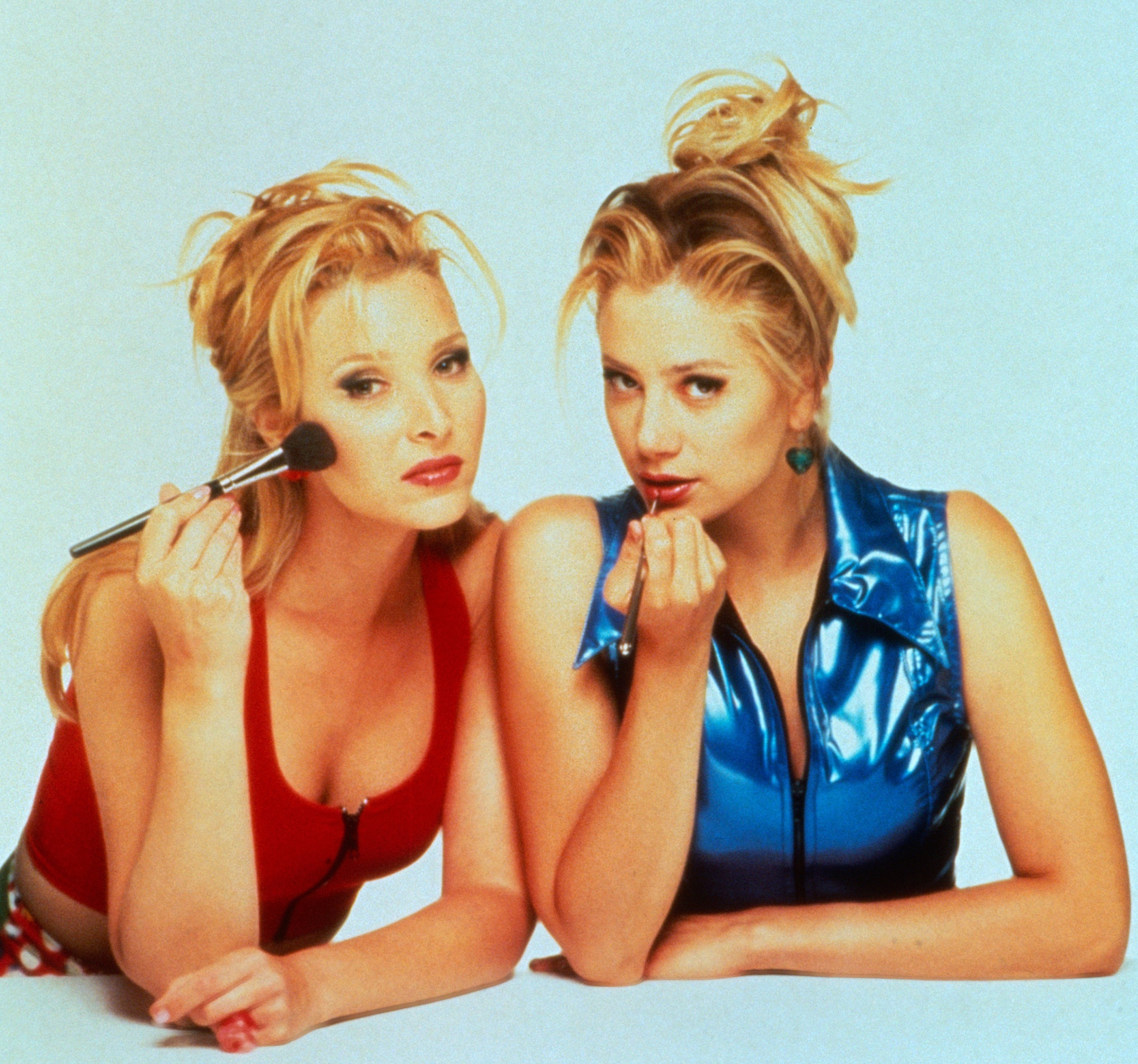 A promotional photo of Lisa Kudrow and Mira Sorvino as Romy and Michele putting on makeup