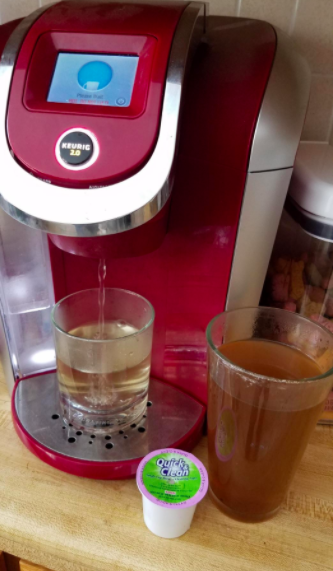 Reviewer photo showing the dirty liquid coming out of their Keurig while using a Quick & Clean cleaning pod