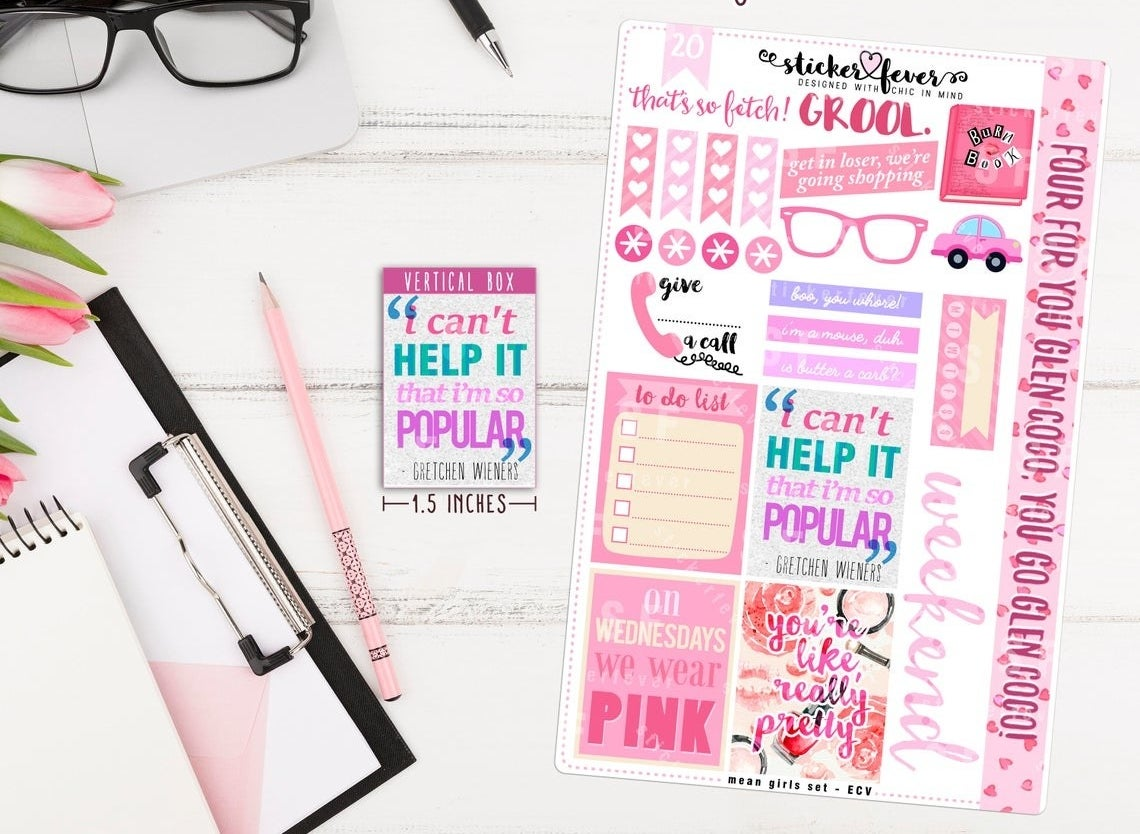 A sheet of colourful stickers next to a notebook with a pencil