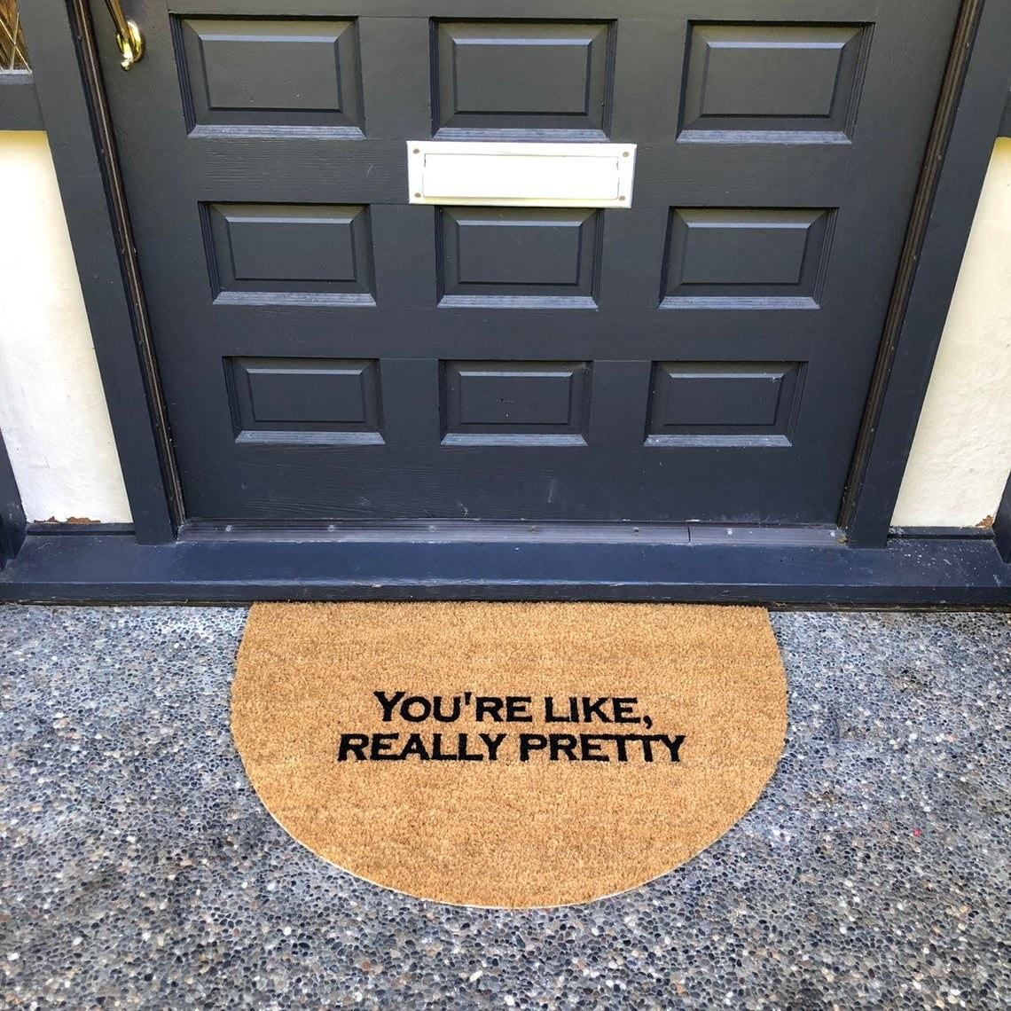 A rounded door mat that says You're like really pretty