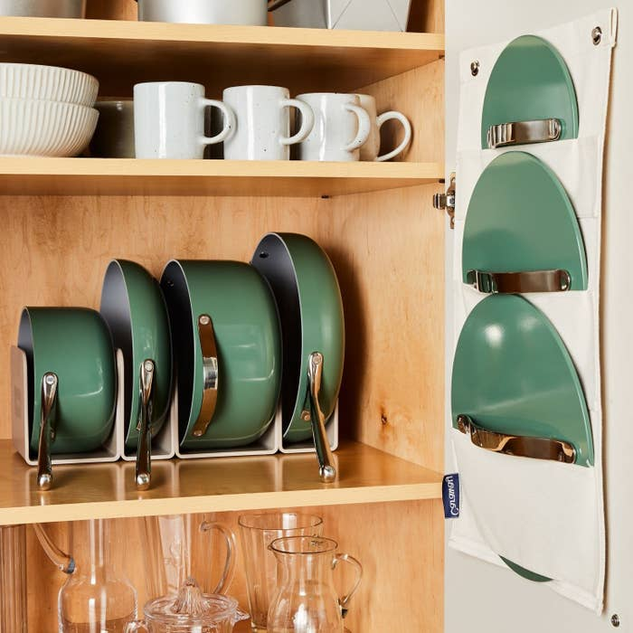 The four pants in green in the rack in a cabinet with the lid holder with the green lids in the slots hanging on the door