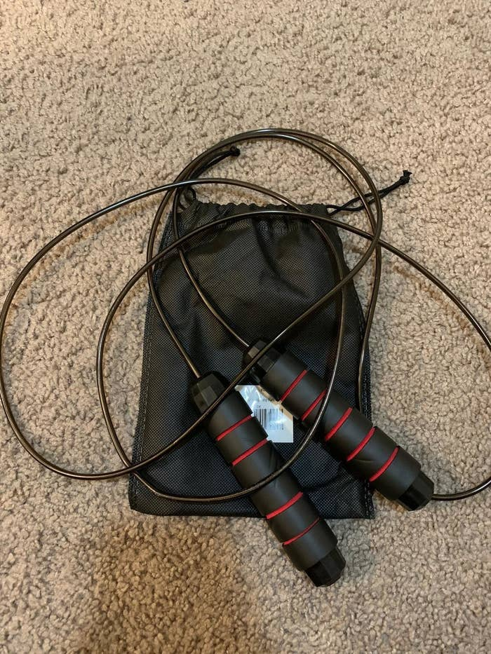 A reviewer showing the jumprope with a carrying bag