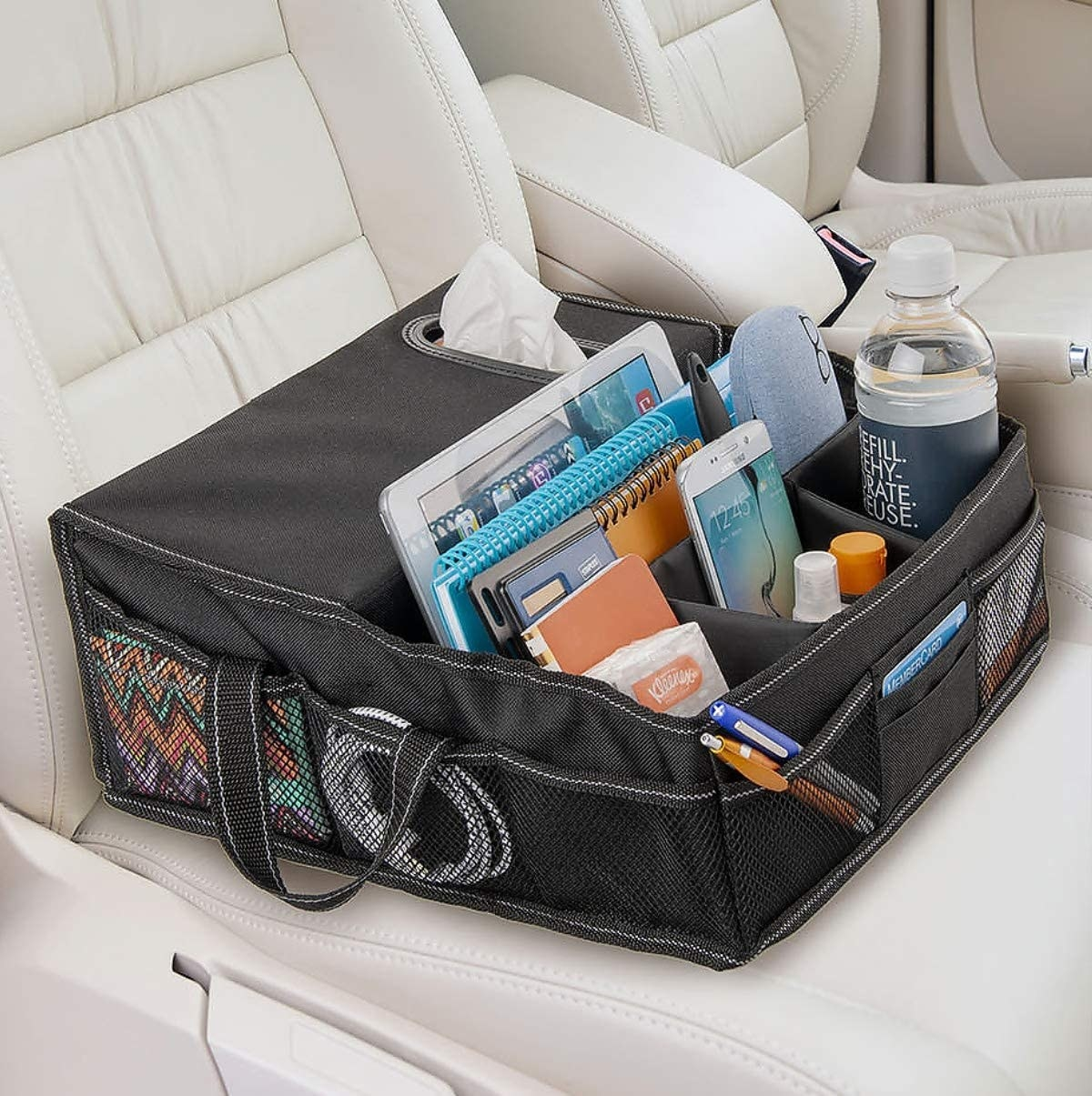 A front seat organizer with different compartments for small things like phones, bottles, and glasses