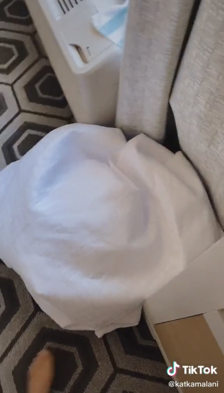 Pile of comforters on hotel floor