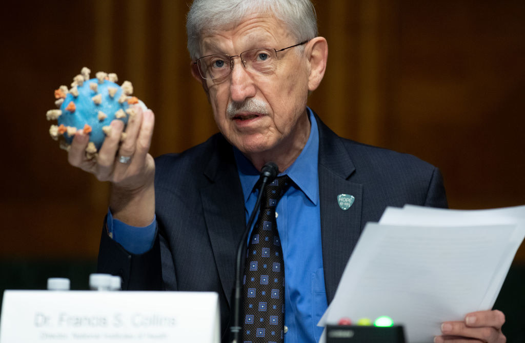 Francis Collins, Director of the National Institutes of Health, holds up a model of a coronavirus when testifying to the Senate about Operation Warp Speed in July.