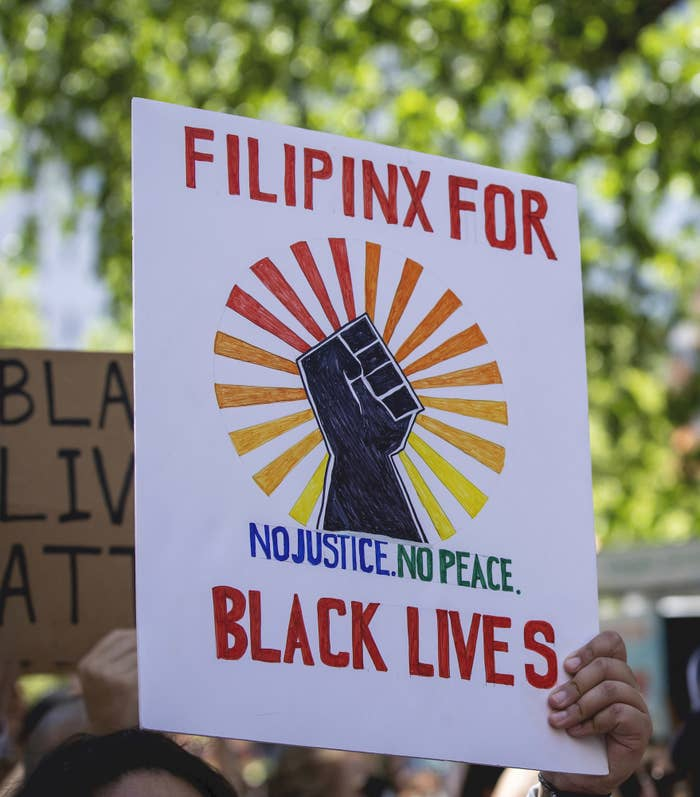 """A protest sign that says, """"Filipinx for Black Lives. No justice. No peace,"""" with an illustration of a fist"""