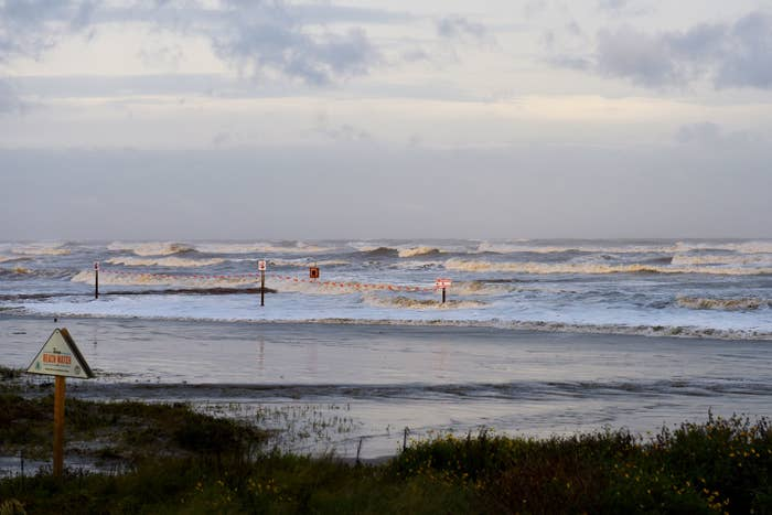 High surf from Hurricane Laura covers a jetty in Galveston, Texas
