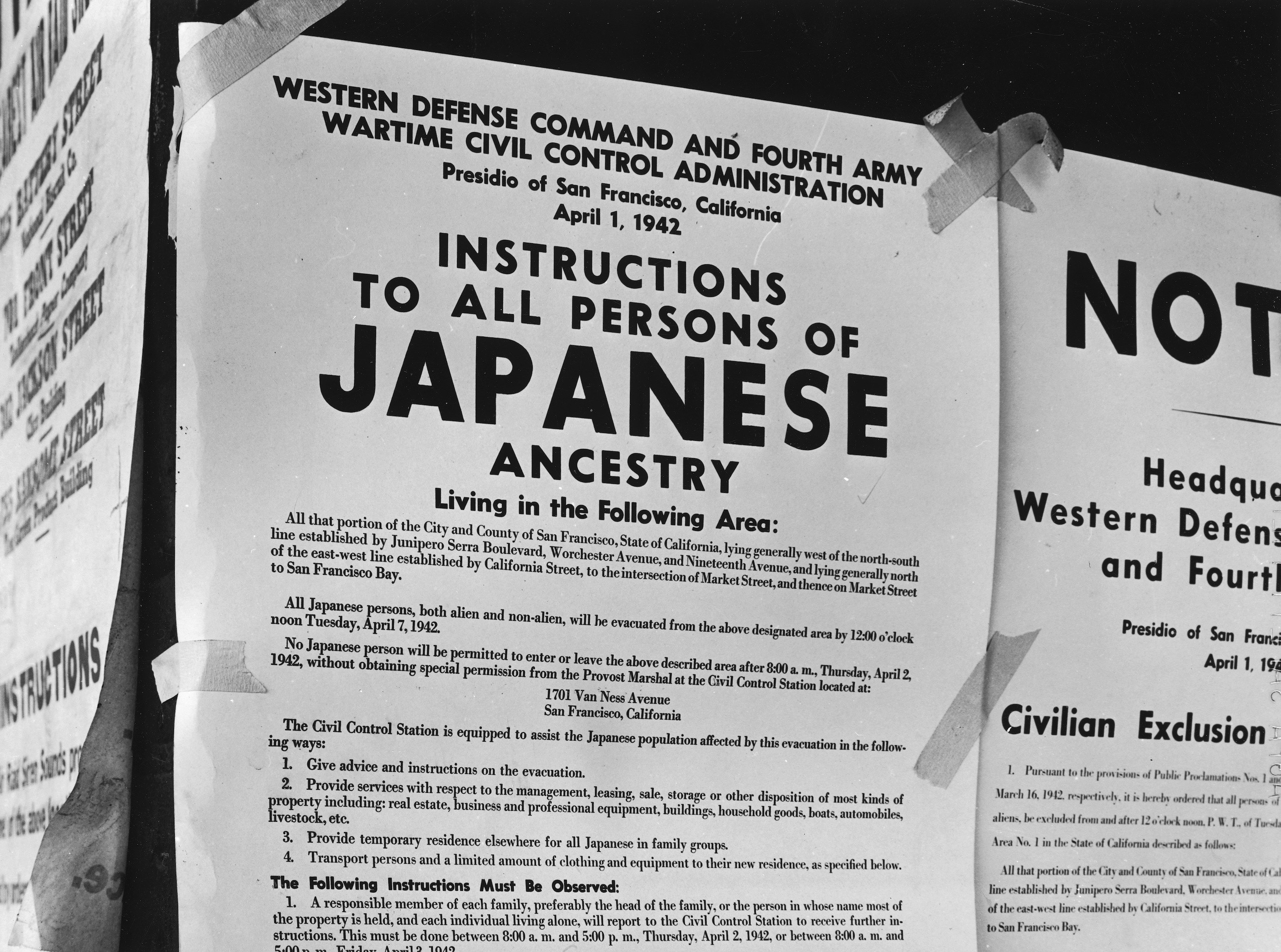 """A flyer taped to a building in San Francisco that reads, """"Instructions To All Persons Of Japanese Ancestry,"""" and orders them to be evacuated to internment camps"""