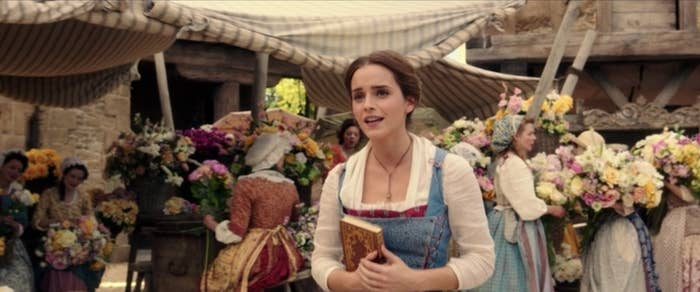 """Emma Watson as Belle walking through town during the opening number, """"Belle"""""""
