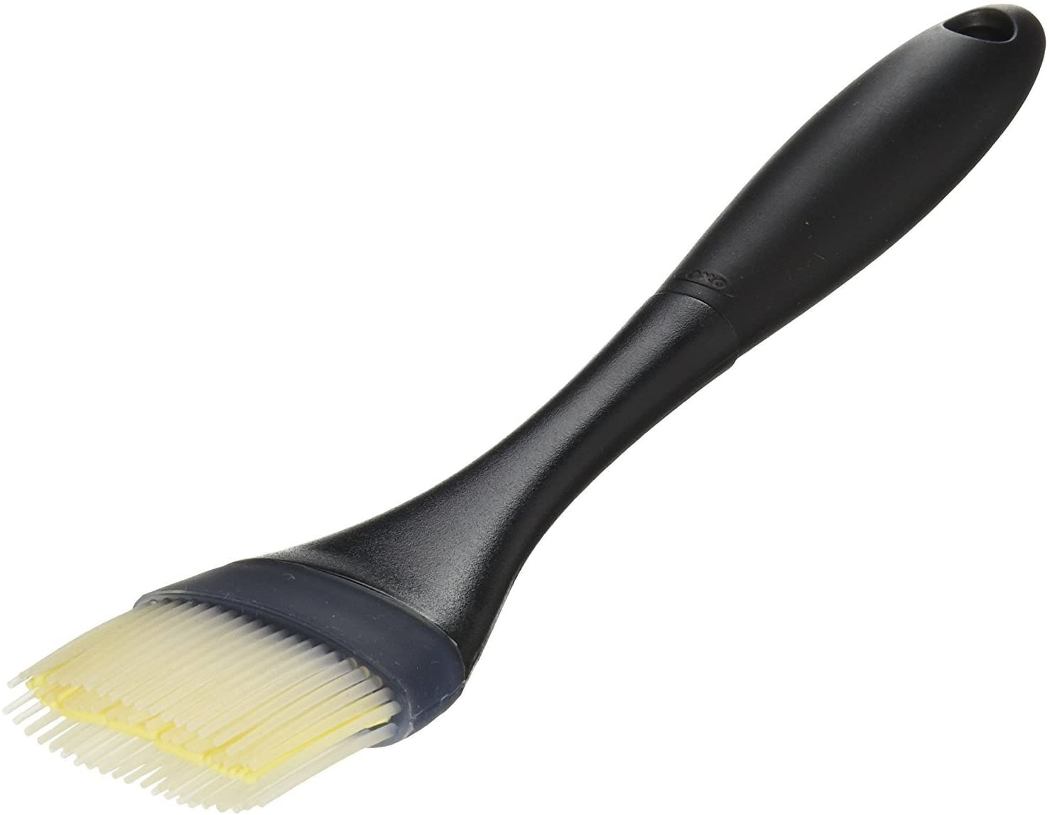 pastry brush with black handle and three layers of clear bristles