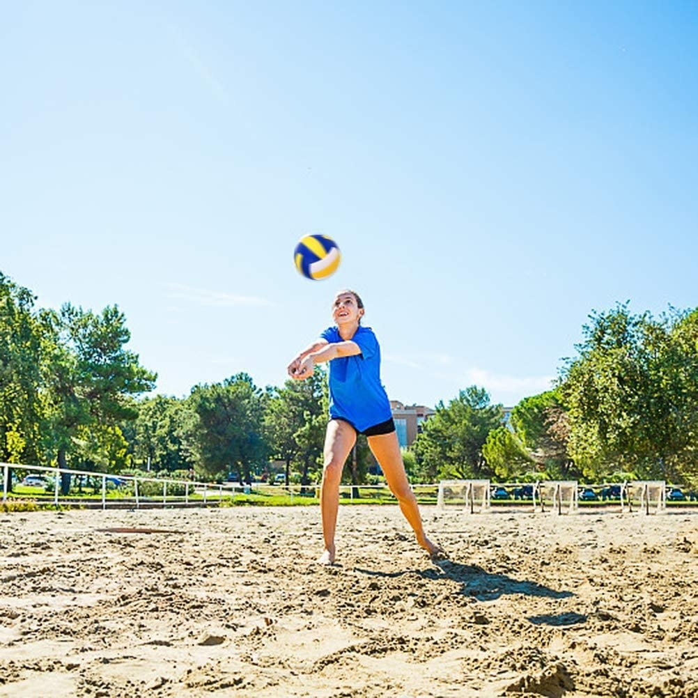 A model bumping a volleyball into the air