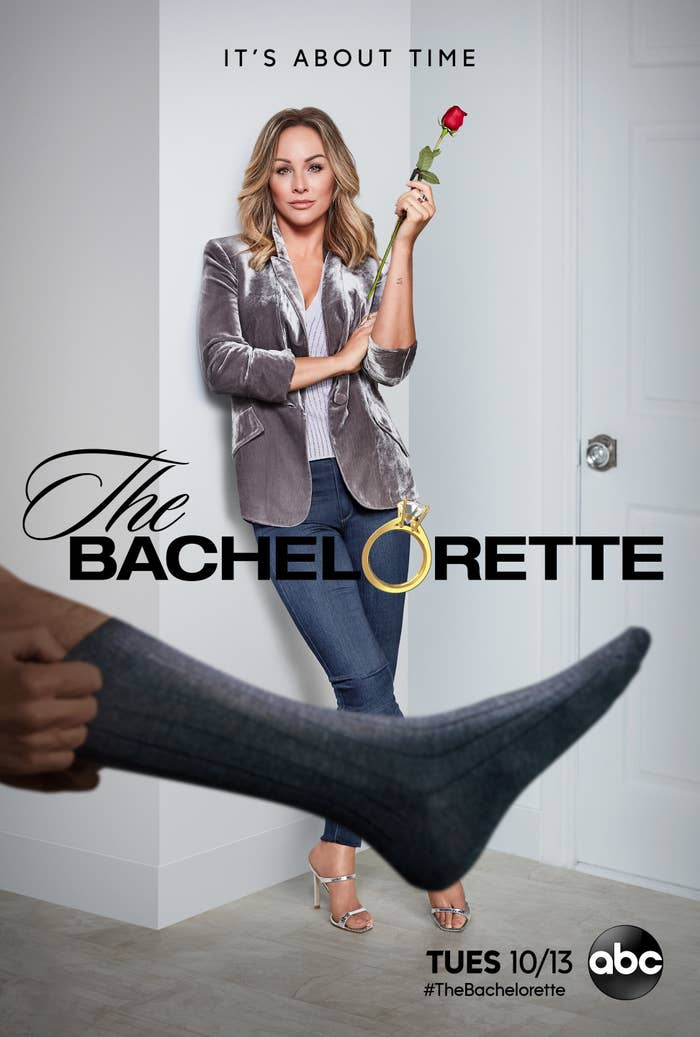 Clare Crawley standing against a wall with a mysterious man's leg photoshopped in front of her