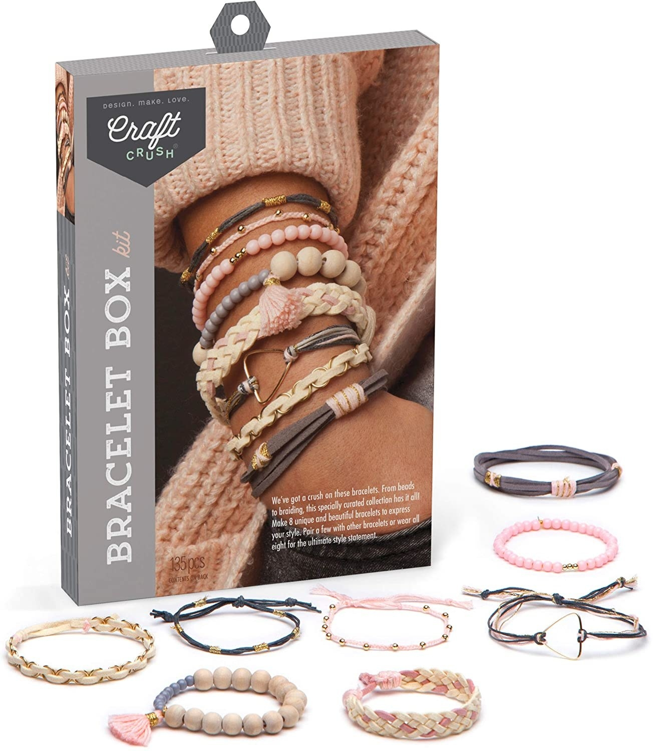 The kit which includes supplies to make beaded, braided, and string bracelets that are a combination of pink, tan, gray, and gold