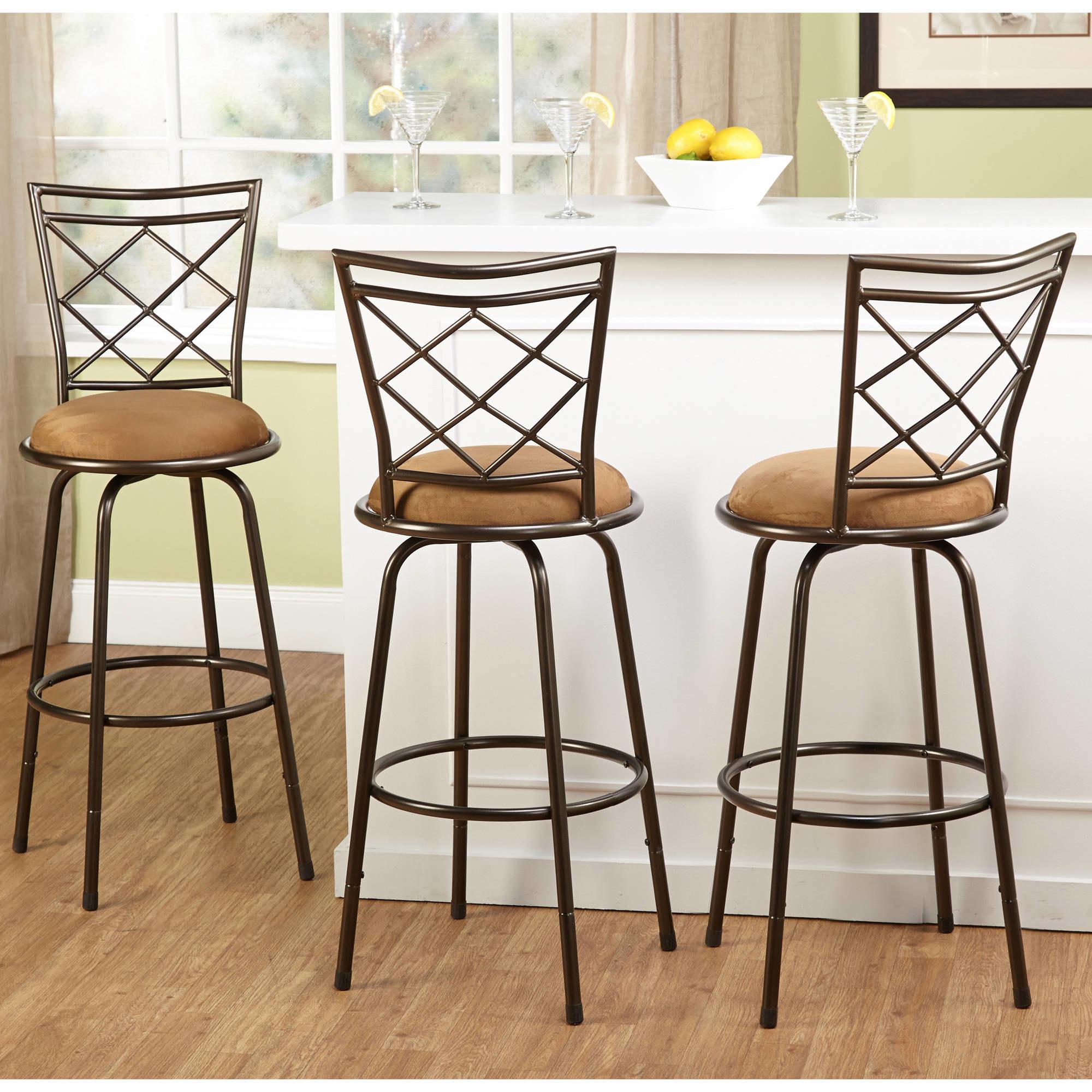 three bar stools at a kitchen bar