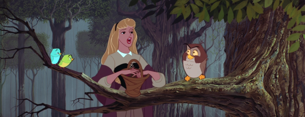 """Aurora singing to birds on a branch in the forest during """"Sleeping Beauty"""""""