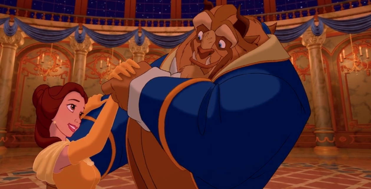 Belle and Beast dancing in the ballroom of the castle during the animated-version of the movie