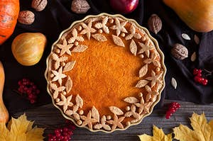 An autumn pie with leaves surrounding the edges