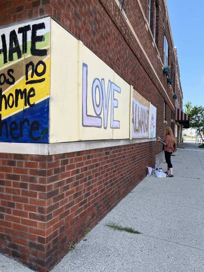 "Murals say ""hate has no home here"" and ""Love"""