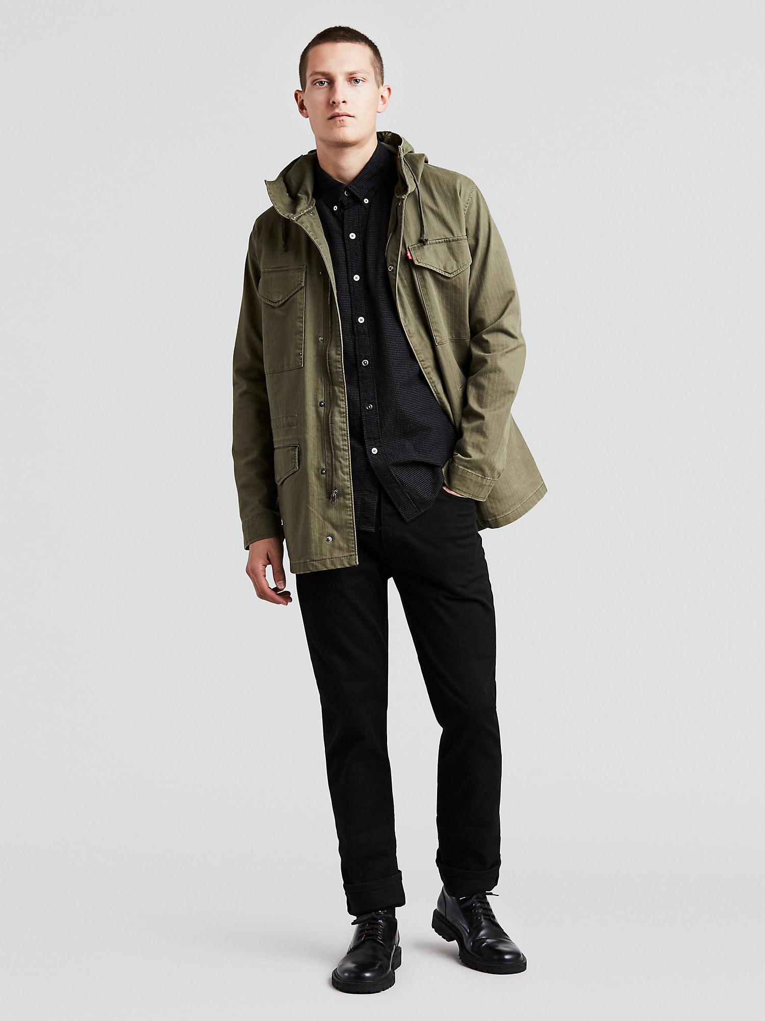 model wearing black levi's jeans