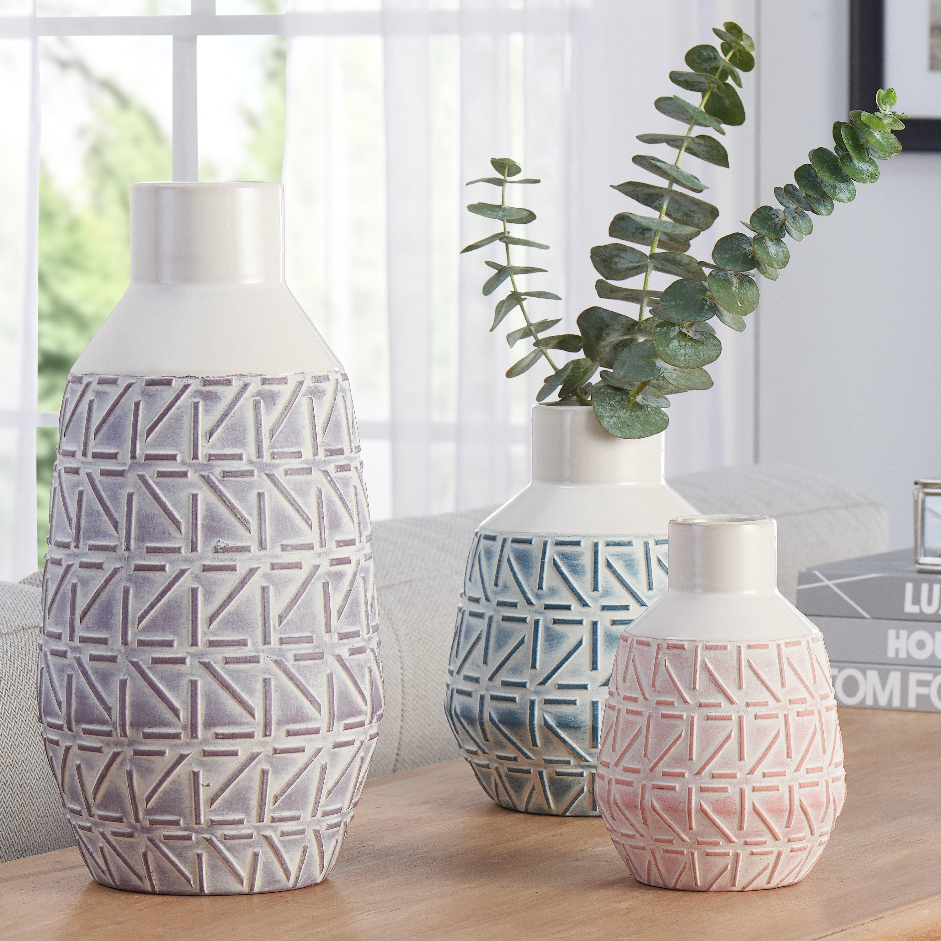 three better homes and gardens vases in purple, pink, and blue