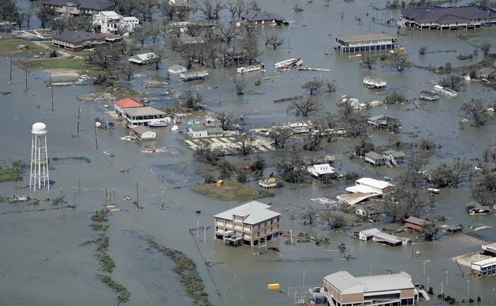 An aerial shot shows the town of Lake Charles submerged in water