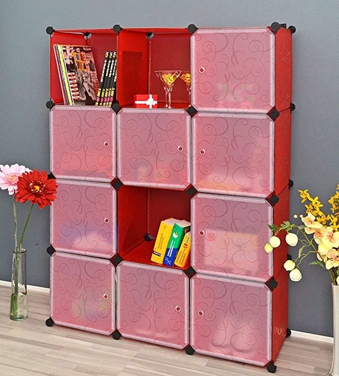 Red storage cubes filled with books and toys.