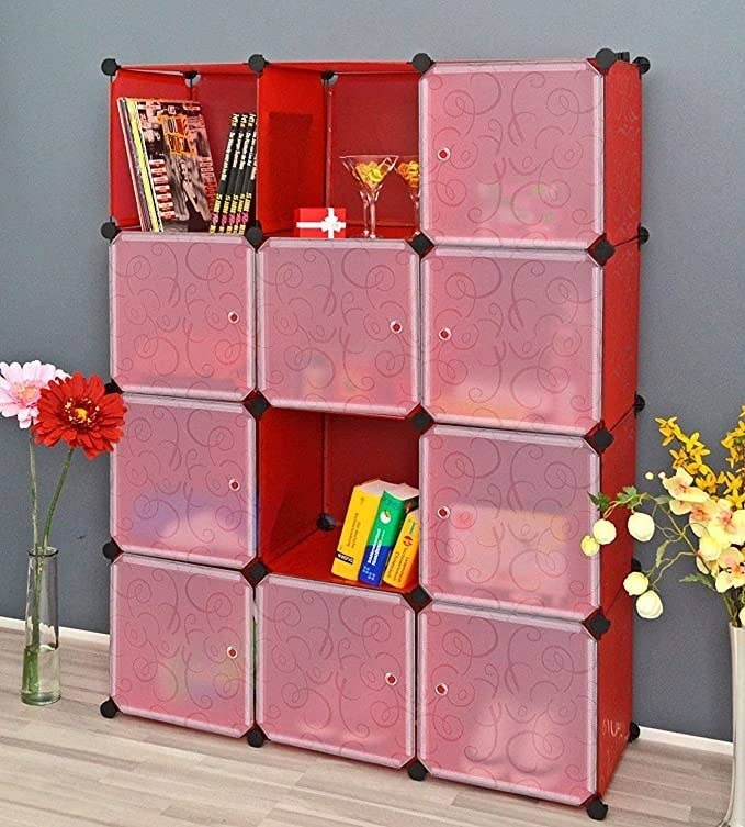 Red storage boxes with clear plastic doors.