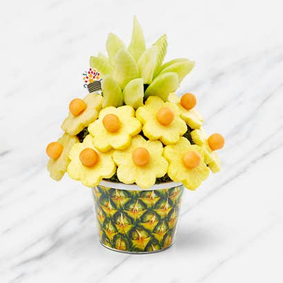 Pineapple fruit display in the shape of flowers