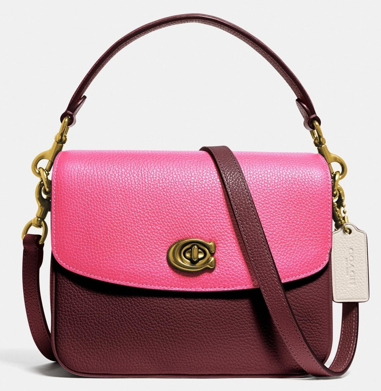 Maroon crossbody with hot pink flap and burnished gold metal handle hooks and clasp