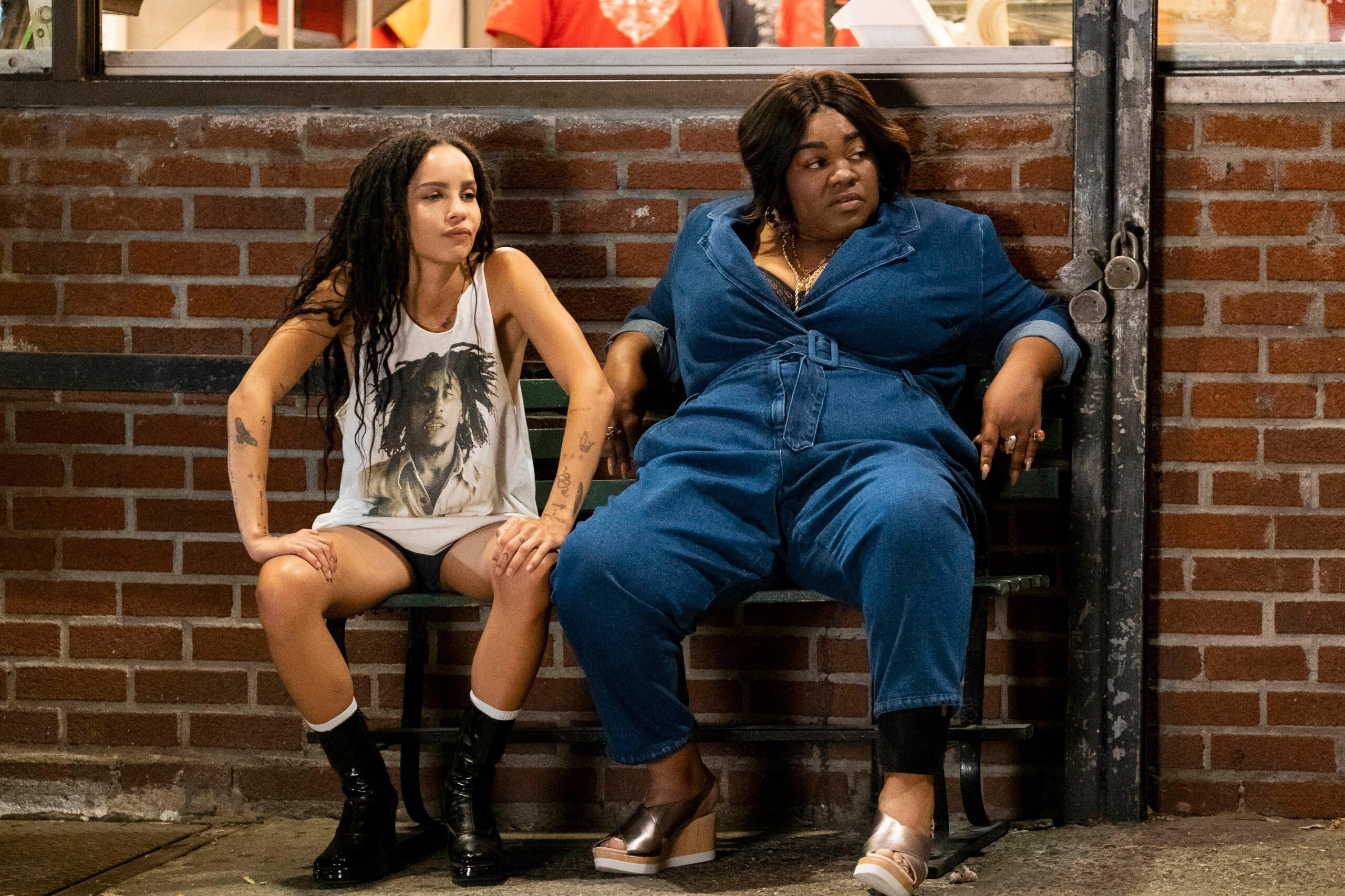 "A ""High Fidelity"" still of Zöe Kravitz and Da'Vine Joy Randolph sitting on a bench"