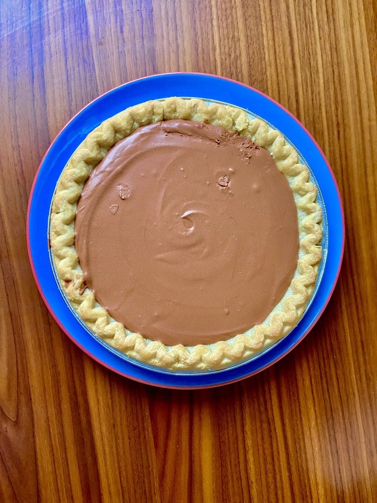 A pie crust with a chocolate filling