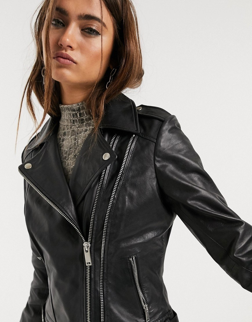 Model in a zipped-up black leather motorcycle jacket