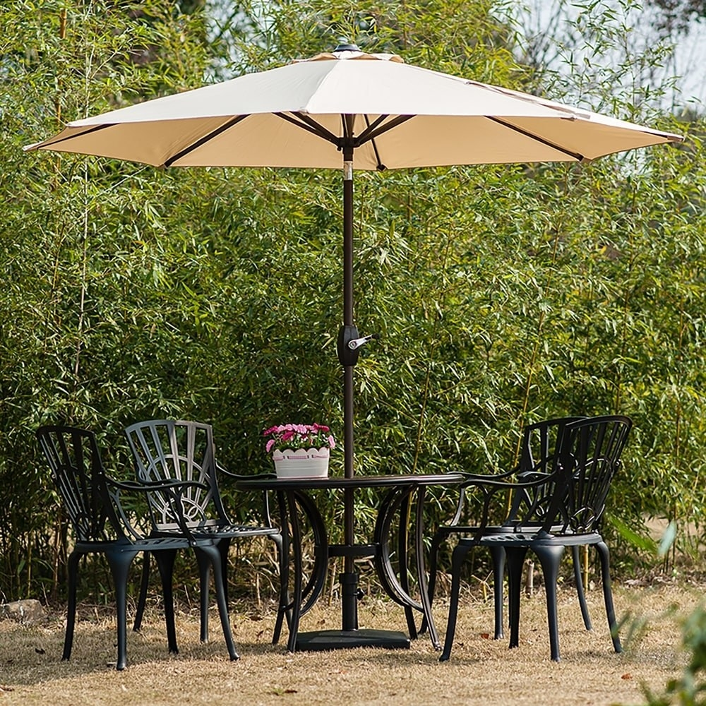 Patio umbrella over a table and chairs