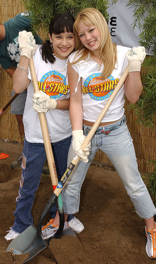 Hilary Duff and Lalaine happily shoveling some dirt together